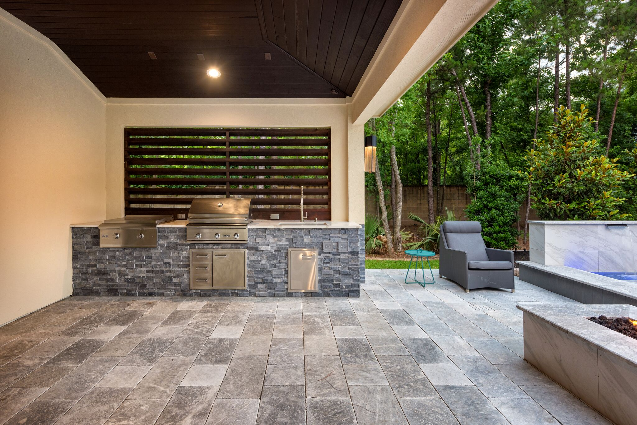 Outdoor living spaces regal pools the woodlands tx - Outdoor living spaces with fireplace ...